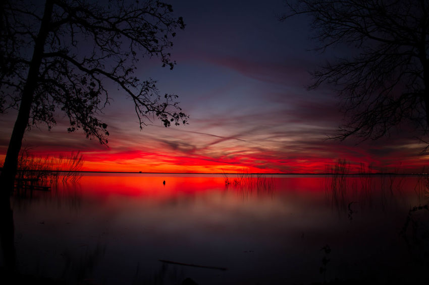 Beauty Beauty In Nature Blue Colors Lake Lake View Lakes  Lakeshore Lakeside Lakeview Landscape Nature No People Outdoors Red Reflection Reflection Sky Sunset Sunset Silhouettes Sunsets Textured  Water