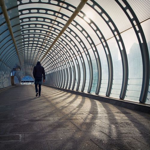 Arch Architecture Built Structure Casual Clothing Day Diminishing Perspective Full Length Leisure Activity Lifestyles The Way Forward Tunnel Vanishing Point Walkway