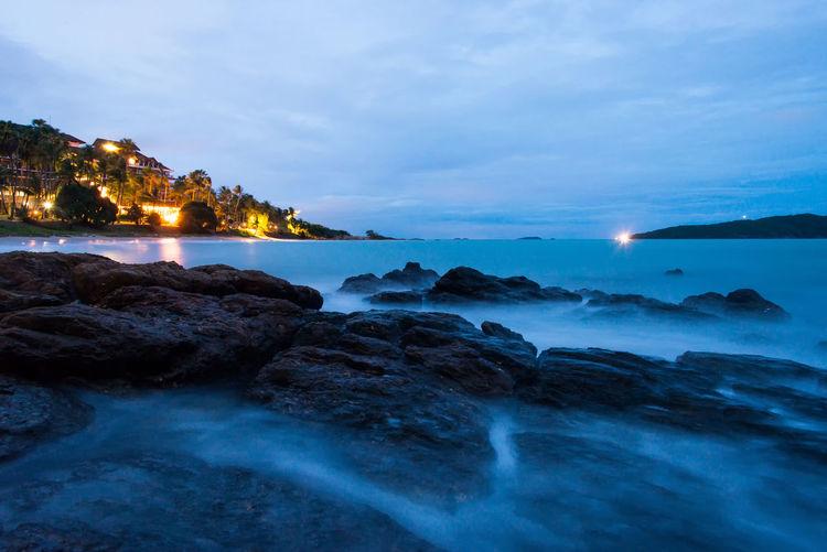 Slow Sea Waves Pile Up Rocks at Night.