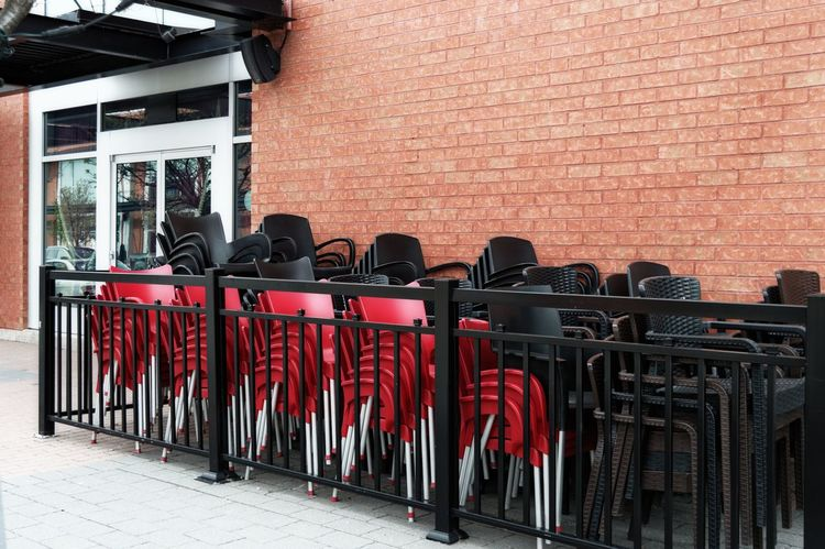Architecture Black Brick Wall Building Exterior Built Structure Centropolis Chair Chairs Day In A Row Large Group Of Objects No People Outdoors Red Stacked Stacked Chairs Streetphotography Terrasse