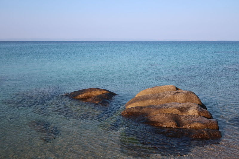 Rocks in shallow water Landscape_Collection Nature Beach Blue Clean Clear Sky Greece Horizon Horizon Over Water Landscape Nature No People Outdoors Rocks Scenics - Nature Sea Seascape Shallow Shallow Water Sithonia Sky Tranquil Scene Tranquility Turquoise Water