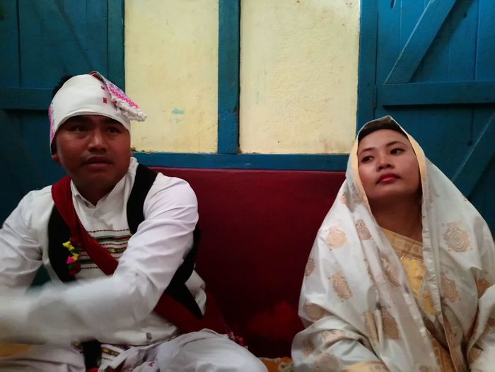 Couple sitting at wedding ceremony