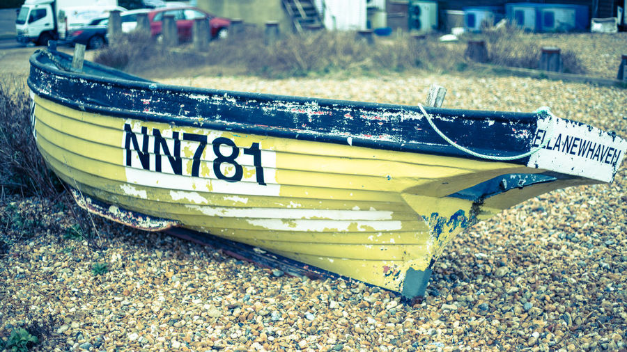 Transportation No People Nature Western Script Nautical Vessel Mode Of Transportation Close-up Outdoors Water Yellow Land Focus On Foreground Selective Focus High Angle View Number Still Life Moored Boat Beached Fishing