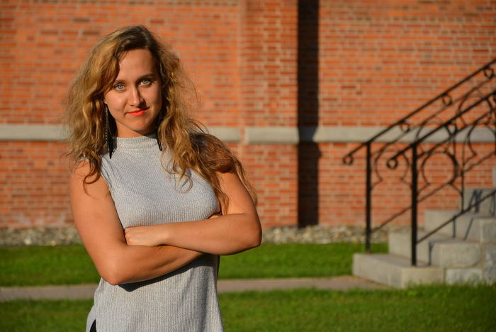 Business Kid Arms Crossed Looking At Camera Portrait Real People Seriousness  University