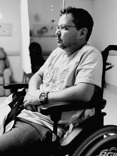 Man sitting on wheelchair at home