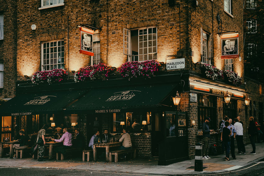 Adult Architecture Bar Beer Time Building Building Exterior Built Structure Business City Flowering Plant Group Of People Lifestyles Men Night Outdoors People Real People Restaurant Street Table Text Walking Window Women #urbanana: The Urban Playground