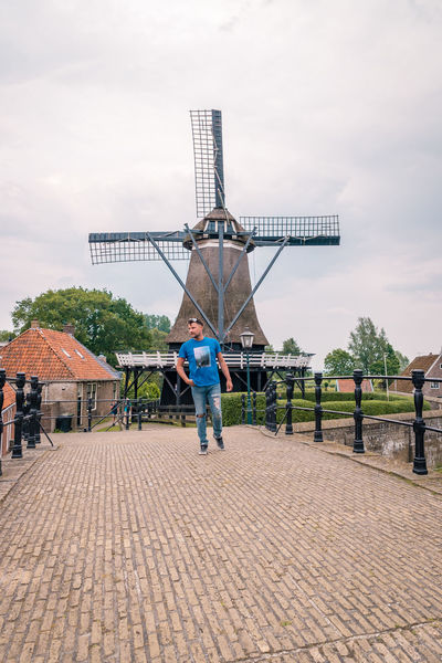 Netherlands Architecture Building Building Exterior Built Structure Casual Clothing City Cloud - Sky Day Dutch Footpath Freisland Friesland Town Full Length Lifestyles Men Nature One Person Outdoors Real People Rear View Sky Sloterdijk Town Walking