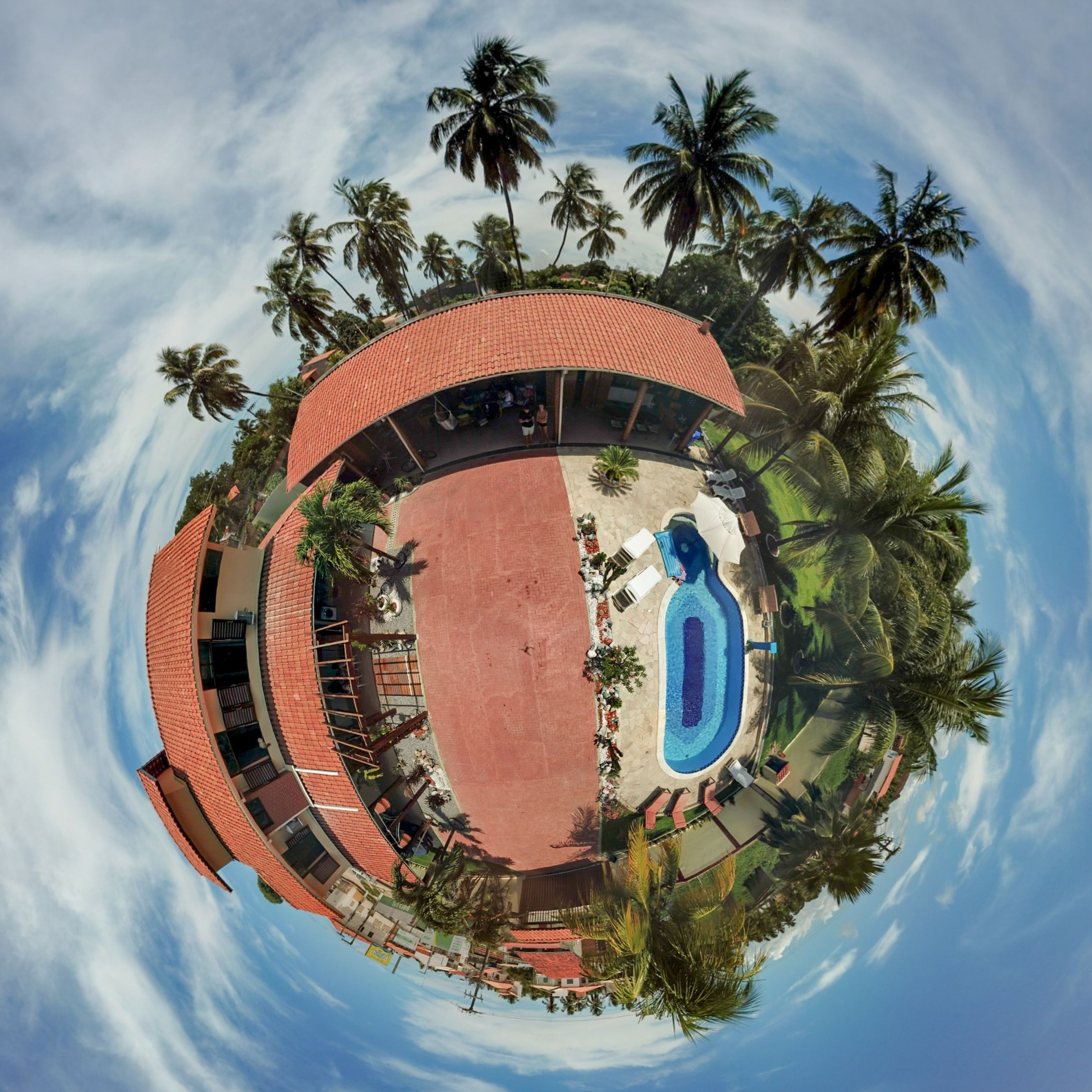 tree, palm tree, sky, cloud - sky, tropical climate, nature, plant, building exterior, circle, built structure, day, architecture, fish-eye lens, no people, shape, geometric shape, reflection, low angle view, outdoors, water, digital composite, swimming pool, distorted image