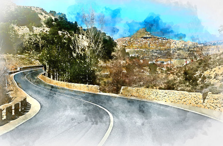 Digital watercolor painting of Morella. Morella is an ancient gothic city located on a hill-top in the province of Castellon, Valencian Community, Spain. Morella is in the heart of the historic region of Meastrazgo, and it is listed as one of the most beautiful towns in Spain Day Digital Art Digital Watercolor Digital Watercolor Painting Digitally Generated Image Europe Gothic Architecture History Landmark Landscape Meastrazgo Morella Mountain Mountain Road Nature Outdoors Road Roadway SPAIN Travel Destinations Village Watercolor Winding Road