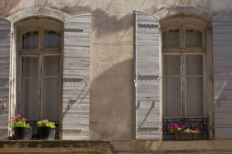 Building exterior at the old town, Arles Architecture Building Exterior Built Structure Day Exterior Façade Flower Growth Historic History House Outdoors Plant Potted Plant Residential Building Residential Structure Shadow Sunny The Past Tourism Travel Destinations Window