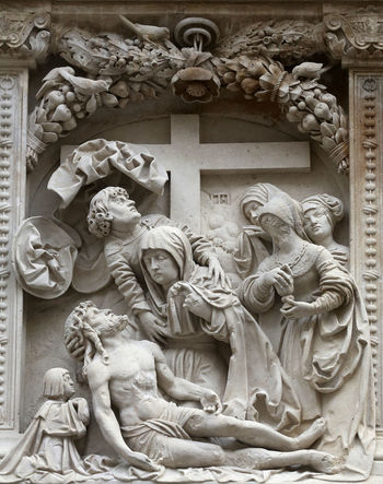 Lamentation of Christ Architectural details from the external walls of St Stephen's Cathedral in Vienna, Austria on October 10, 2014. Art Austria Calvary Carving Carving - Craft Product Cathedral Christ Christianity Craft Creativity Crucifixion Faith Jesus Lamentation Relief Religion Sacred Saint Savior Spirituality Statue Stephen Vienna Virgin Mary Worship