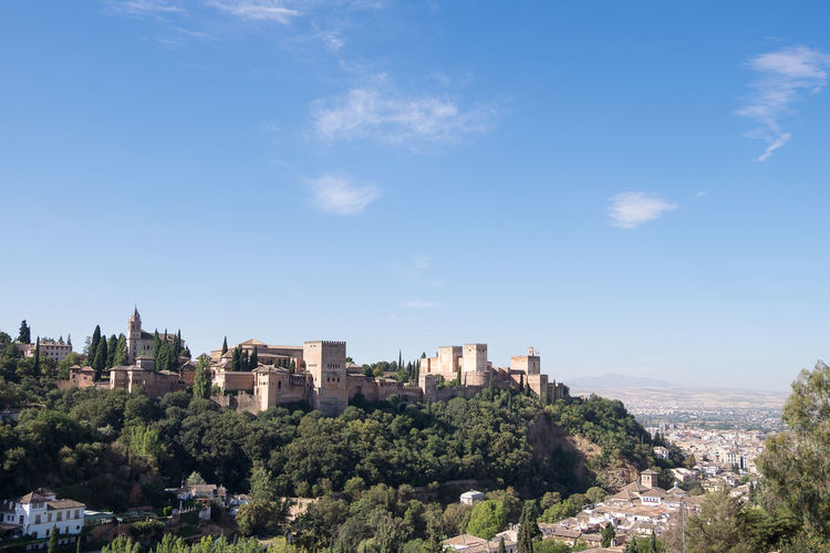 The Alhambra perched on a hill top in Granada with copy space Andalucía Andalusia Castle Copy Space Granada SPAIN Tourist Attraction  Alhambra Architecture Blue Building Exterior Built Structure City Cityscape Europe Fortress Hill Top Nature No People Outdoors Palace Sky Sunlight Tourism Travel Destinations
