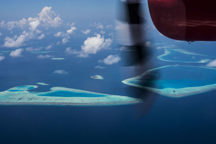 View from the seaplane Maldives Airplane Wing Beauty In Nature Beutifulplace Blue Blueocean Close-up Day Flying Horizon Over Water Maldivesphotography Mid-air Motion Nature No People Outdoors Scenics Sea Sky Swimming Pool UnderSea Underwater Water