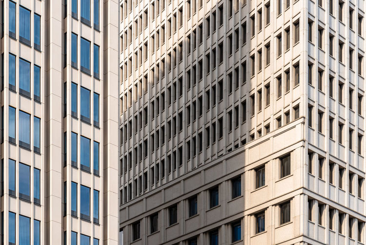 Full frame pattern of windows in office building. berlin, germany. abstract background