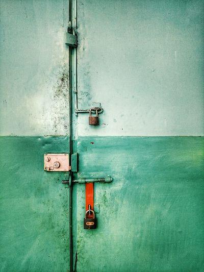 Close-up of locked metal door
