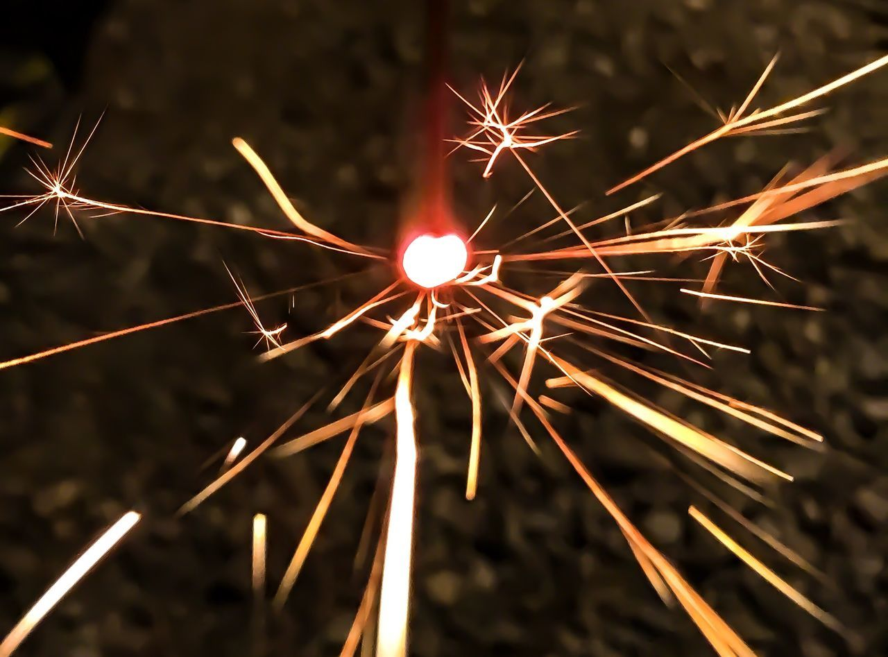 celebration, sparks, firework - man made object, illuminated, night, sparkler, long exposure, firework display, glowing, motion, no people, burning, blurred motion, outdoors, arts culture and entertainment, close-up, firework, diwali, sky