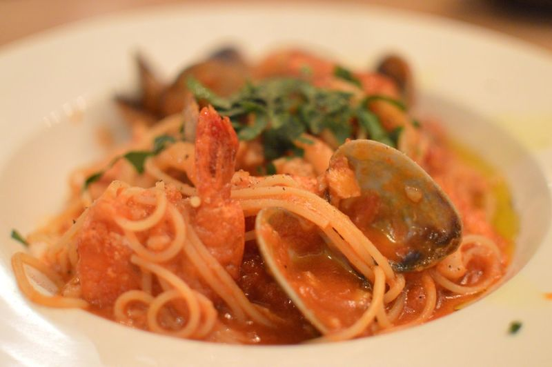 Close-up of spaghetti pasta with clams served in bowl