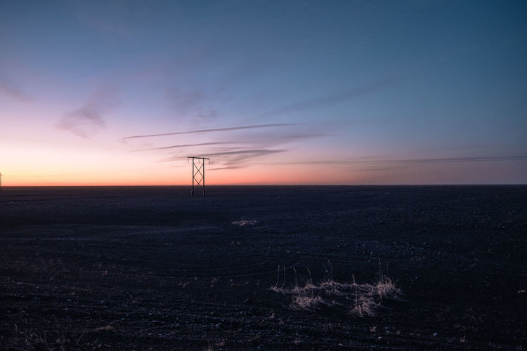 Power lines in East Iceland Sky Sunset Scenics - Nature Environment Fuel And Power Generation Nature Landscape No People Tranquil Scene Tranquility Land Beauty In Nature Orange Color Horizon Non-urban Scene Electricity  Technology Field Outdoors Silhouette Power Supply Iceland