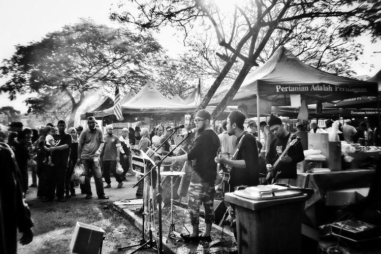 Buskers performing. Busker Music Musician Live Music Eyem EyeEm Best Shots EyeEm Best Shots - Black + White Large Group Of People Men Real People Day Women People Adults Only Outdoors Adult Tree Sky Crowd