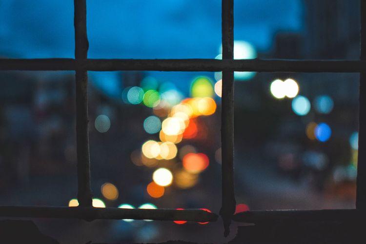 Defocused lights seen through window
