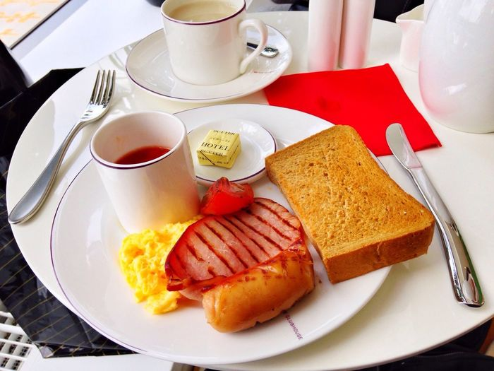 High angle view of english breakfast served with coffee in restaurant