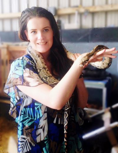 Holding A Snake For First Time Snake Looking At Camera Portrait Smiling One Person Real People Happiness Young Adult Lifestyles Young Women Indoors  Beautiful Woman Day Close-up People