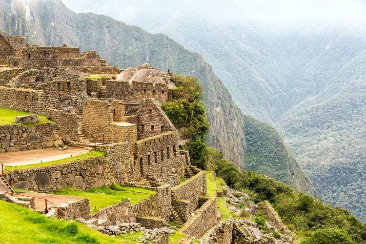 View of ruins at Machu Picchu, Peru Ancient Andes City Civilization Culture Cusco Cusco, Peru Cuzco Famous Inca Landmark Lost Machu Picchu Mountain Old Panorama Peru Ruin Stone Tourism Travel Unesco UNESCO World Heritage Site Valley World