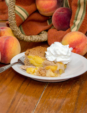 fresh home made cobbler made with Michigan ppeaches Agriculture Dessert Fresh Produce Hello World Nature Orange Summertime USA Vitamins Food Fresh Fruit Healthy Eating Home Made Juicy Just Picked Michigan Peaches Organic Peach Peach Cobbler Peaches Produce Sweet Tasty Yellow