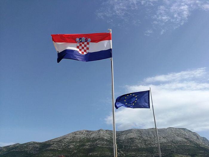 Two Flags Croatian Flag Eu Flag Flag Low Angle View Mountain Patriotism Sky