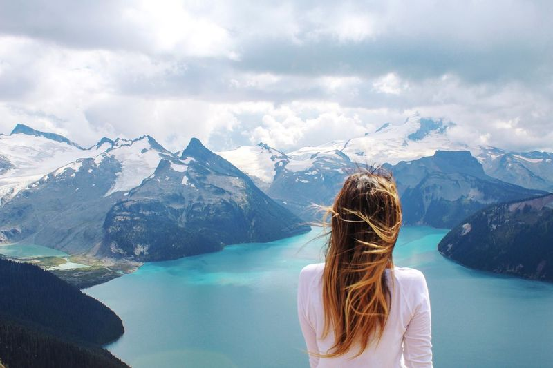 Wind blown hair in the alpine Girl Glacier Canada EyeEmNewHere Emeye Selects Mountain Water One Person Rear View Mountain Range Leisure Activity Scenics - Nature Hair First Eyeem Photo