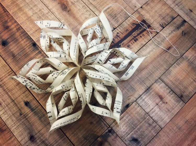 Christmas Paper star Music Notes In The Shape Of A Star Christmas Paper Star Christmas Decoration Christmas Star Paper Star Wood - Material High Angle View Table Indoors  Ribbon - Sewing Item Directly Above Close-up No People Celebration