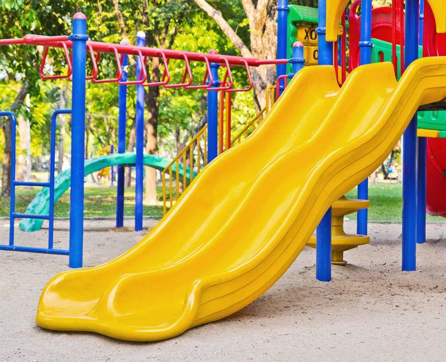 View of yellow playground in park