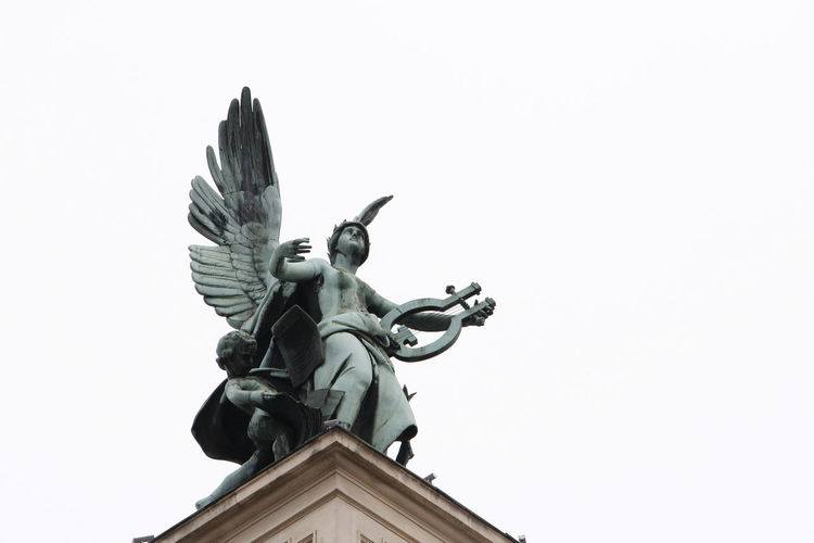 Muse sculpture on the roof of opera house in Lviv Angel Architectural Elements Art Bronze Clear Sky Day Green Inspiration Light And Shadow Low Angle View Lviv Metal Museum Music OpenEdit Opera House Outdoors Roof Sculpture Sightseen Sky Statue Tourist Spot Wing