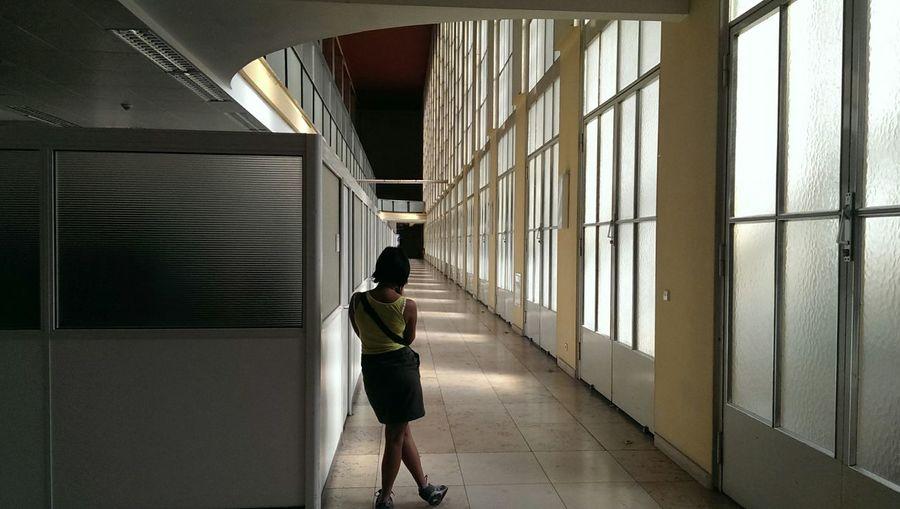 Silhouette of woman standing in corridor