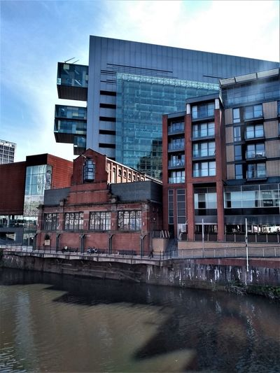 The old pump house on the banks of the River Irwell, Manchester UK with the new construction of the glass Civil Justice Centre directly behind it. Architecture Built Structure Building Exterior Water City Building Waterfront Sky No People Nature River Day Modern Reflection Window Office Building Exterior Glass - Material Outdoors Pump House Old Versus New Old Architecture New Architecture River Irwell Manchester UK Salford