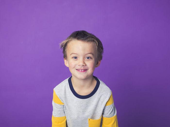 Boy Against Purple Background