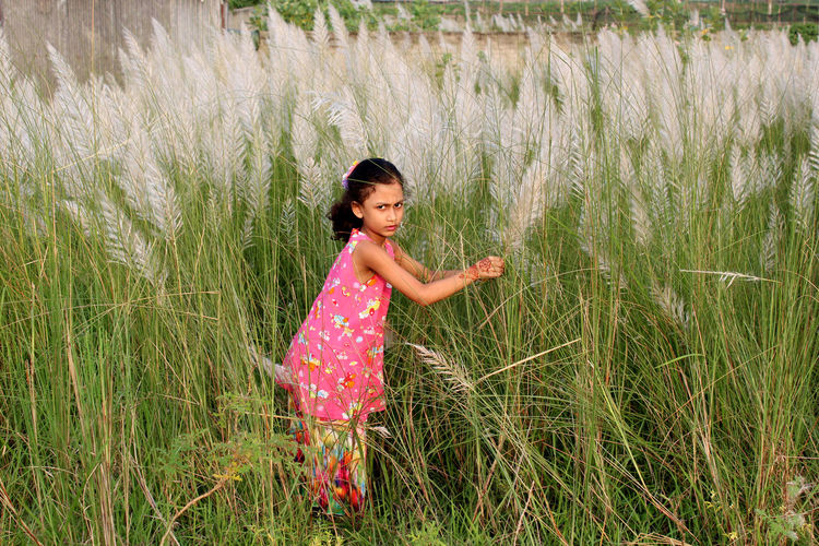 Full Length Of Girl On Grassy Field