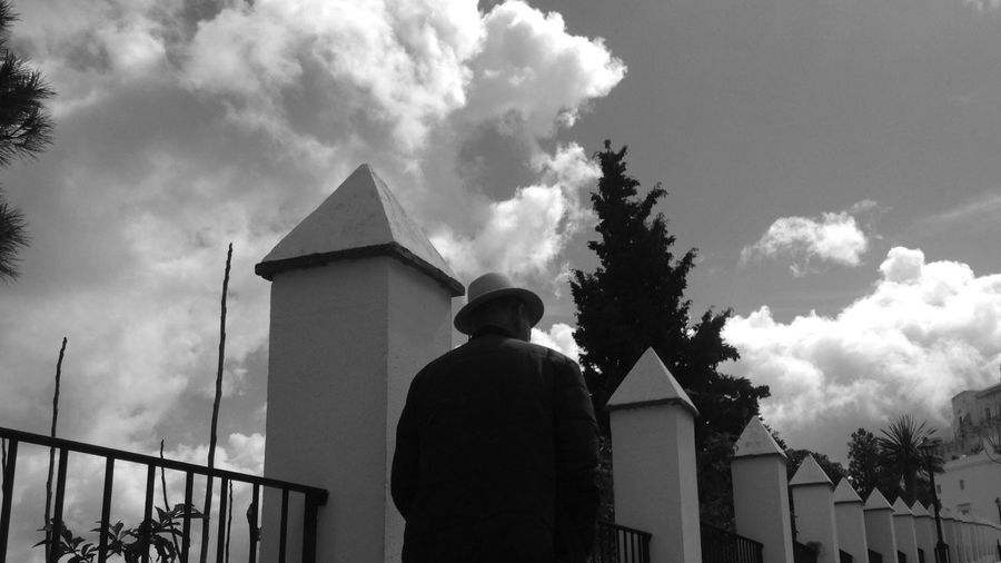 Rear view of man standing against sky