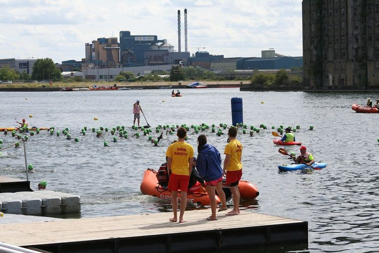 Adults Only Architecture Bright Calm Canoe Day Large Group Of People London Docklands London Triathlon Outdoors People Safety Boat Safety Crew Sky Swim Swimming Water