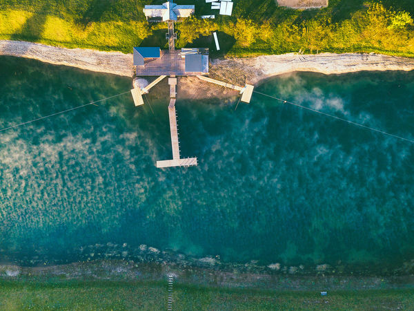 Fog over the lake Fog Over The Lake Kaunas County Aerial View Beauty In Nature Day High Angle View Luxury Nature No People Outdoors Plant Pool Reflection Sea Sunlight Swimming Pool Tranquil Scene Tranquility Tree Turquoise Colored Water Waterfront