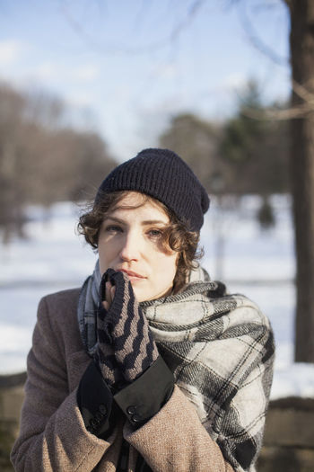 Portrait of young woman wearing hat during winter