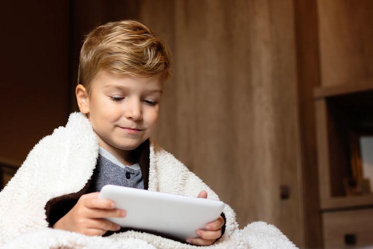 Cute boy using mobile phone