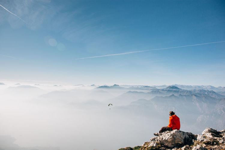 The Traveler - 2018 EyeEm Awards Mountain Adventure Flying Full Length Red Men Sport Warm Clothing Mid Adult Sky Paragliding