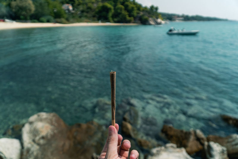 420 Cannabis DOPE Drug Grass Green Rock Roll Smoke Trip Vacations Addiction Blue Blurred Background Close-up Ganja Joint Marijuana Medical Open Door Paper Preparation  Sea Sun Weed