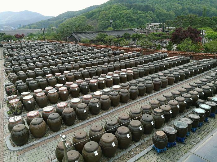 Traditional Korean Jar - Onggi Food Onggi Fermented Food Traditional Container Jars  Crocks Preservation Gochujang Pottery In A Row High Angle View Arrangement Doenjang Stew Kanjang