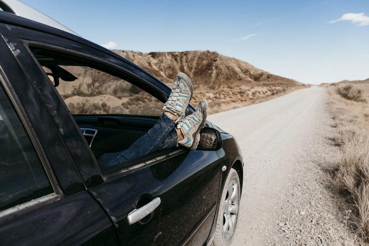 Car on dirt road in desert