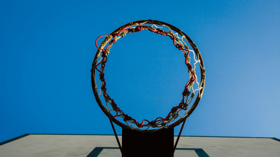 Basketball - Sport Basketball Hoop Blue Circle Clear Sky Copy Space Creativity Day Design Directly Below Geometric Shape Low Angle View Metal Nature Net - Sports Equipment No People Outdoors Pattern Shape Sky Sport A New Beginning