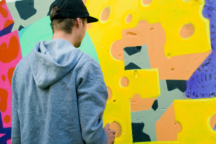 Casual Clothing Colorful Graffiti Graffiti Art Graffiti Wall Guy Hands At Work Modern Modern Art Mural Mural Art Outdoor Photography Outdoors Painting People And Places People Of EyeEm Street Street Photography Young Young Adult Youth Of Today