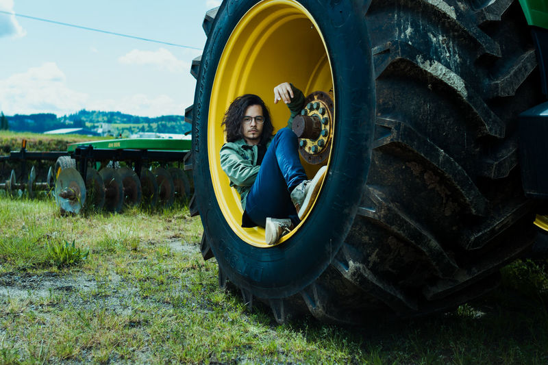 People Relaxation Travel One Person Lying Down Lifestyles Country Life Tractor Green Color Farm Fields Ranch Portrait The Portraitist - 2017 EyeEm Awards