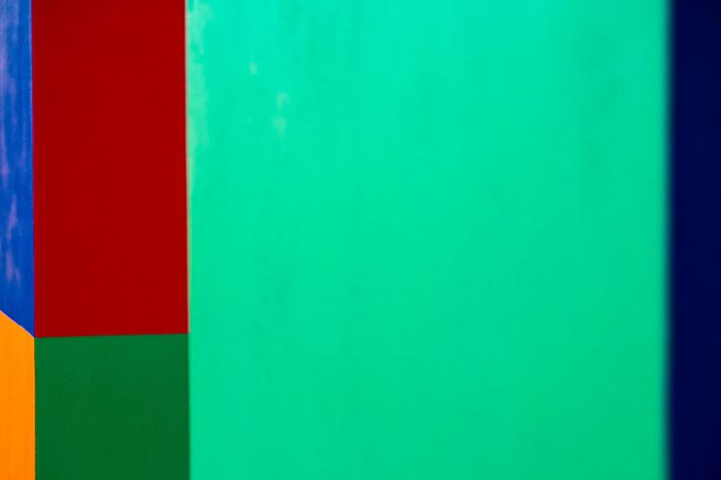 Abstract geometric pattern on concrete wall Abstract Architecture Backgrounds Blue Built Structure Close-up Copy Space Flag Full Frame Green Color Indoors  Multi Colored No People Pattern Red Striped Studio Shot Textured  Vibrant Color Wall - Building Feature